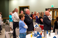 Alumni of the class of 1964 and earlier gather and honor the Briggs for their service.