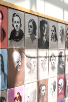 Portraits by students hung in the Spori building.