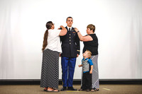 2LT Joshua T. Cheesmore gets his rank pinned on by Darla Cheesmore, his wife, and Peggy Chessmore, his mother.