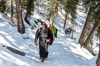 Jimmy Weed and other students hiking down to go ice climbing as part of Outdoor Activities.
