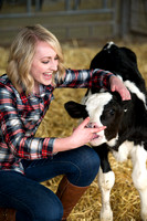 Erica Crabb with a hungry little calf at the Agriculture Science Center.