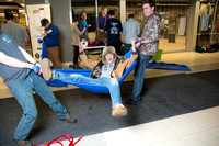 Students learn to make hammocks out of parachute material.