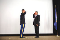 2LT Joshua T. Cheesmore renders his first salute to Todd Chessmore, his father.