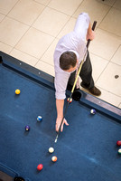Dain Knudson plays pool in the Manwaring Center.