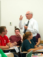 Greg Hazard helps new freshman learn how to be better learners in a Study Skills class.
