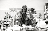 Chemistry teacher, Susan Ward, works with students during their Chemistry lab. December 1995.