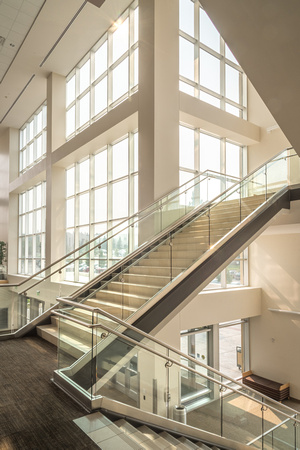 The stairways in the I-Center are lit up as morning light floods in the windows.