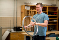 Physics students learn about rotational forces in a lab.