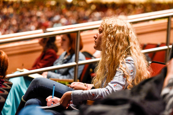 Student taking note at devotional