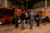 Students taking an Agricultural Machinery class learn how to maintain large equipment.