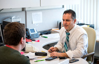 Mathematics Instructor Rich Llewellyn in his office with a student.