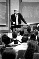 Business Faculty Member addresses audience of Business Majors. March 1994.