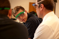 Kendall Peck interacts with his students during the lab of his chemistry 105 class.