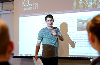 Jake Young gives a presentation in a Humanities class taught by Derek Jensen.