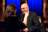President Kim B. Clark, President of BYU-Idaho and Elder Dallin H. Oaks, Quorum of the Twelve Apostles shake hands with students at Brigham Young University-Idaho. Other students await their turn for