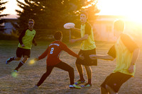Teams compete during an Ultimate Frisbee game.