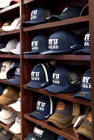 BYU-I hats on shelves in the MC bookstore.