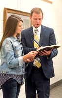 Brother Taylor, of the Religion Department, shares a scripture with a student. 2017