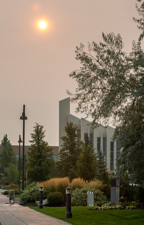 The sun is diffused into a ball of fire over the Taylor Building, due to smoke from wildfires around the region.