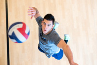 Cameron Olsen spikes the ball during his volleyball class in the I-Center.