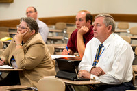 Faculty gather in the Hinckley Building for a conference to learn from their peers.