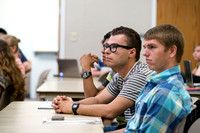 Students in Brother Adamson's Political Science class pay close attention to the material being taught.