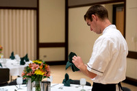 A student pays attention to detail as he prepares the napkins for PAC during the 2014 Spring Semester.
