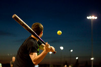 Deric Plummer swings at the softball during a recreational softball game at the 4-plex.