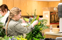 Students at a Bridal Floral Design class taught by Ssiter Cox.