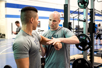 Biology Instructor Joseph Anderson, takes time for students during his training in the BYU-Idaho Fitness Center.
