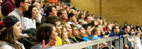 Sudents react to participants in the 3-Point Contest at the Slam Dunk Contest held in the Hart Auditorium.