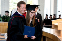 Rob Eaton, Assoicate Academic Vice President gave diploma to his daughter at the College of Eduation and Human Development convocation.