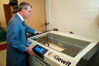 Ron Kinville operates the new Kiewit lazer cutter that was donated to the Architecture and Construction Dept.